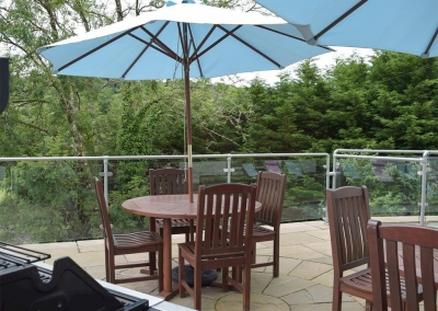 The patio & barbecue area at Hafan Dawel, Stepaside