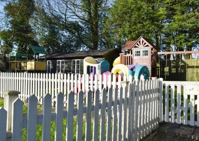 The shared children's play area at Ivy Court Cottages, Llys-Y-Fran