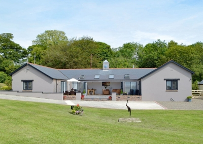Manor Lodge Stables, Wiston near Narberth is a luxury renovated stables with four bedrooms & three bathrooms (one ensuite). Bright, open plan living with woodburner & bi-fold doors onto sheltered terrace. Private garden, parking & panoramic views.