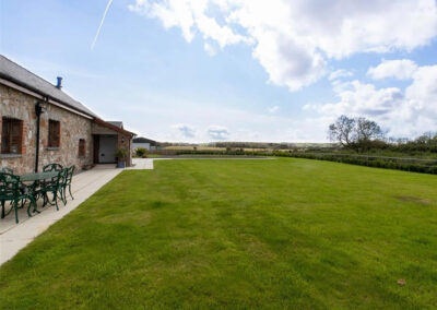 The large enclosed garden at Orchard Barn, St Florence