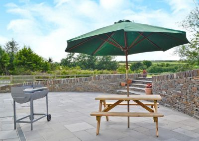 The patio & barbecue area at Penbanc, Wolfscastle