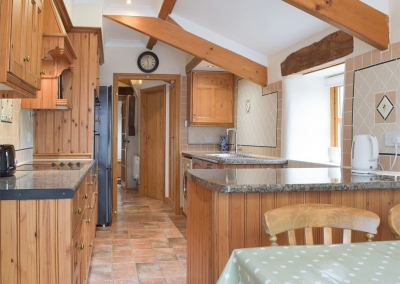 The kitchen & breakfast area at The Byre, Lyserry Barns, St Twynnells