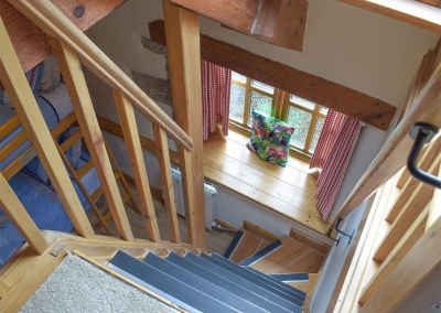 Stairs leading to a galleried seating area from bedroom #3 at The Byre, Lyserry Barns, St Twynnells