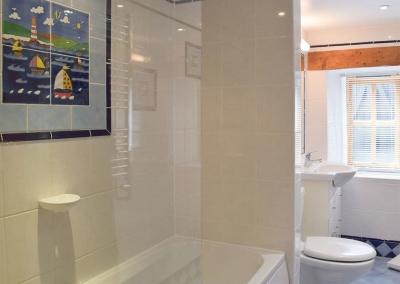 The bathroom at The Byre, Lyserry Barns, St Twynnells
