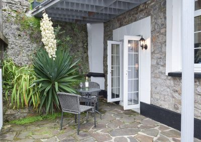 The patio outside the bedrooms at The Coach House, Penally