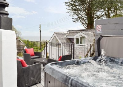 The hot tub & decked terrace at The Coach House, Penally