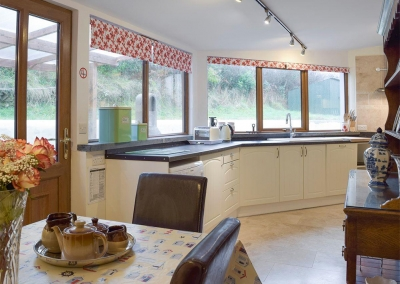 The dining area & kitchen at Ty Hapus, Dwrbach