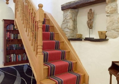 The hall & stairs to the first floor at Ty Hapus, Dwrbach