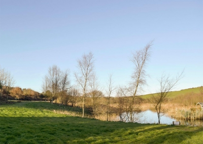 Five acres of natural grounds surround Ty Hapus, Dwrbach