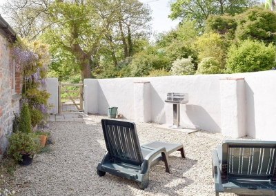 The courtyard & barbecue area at Valley View Barn, St Twynnells