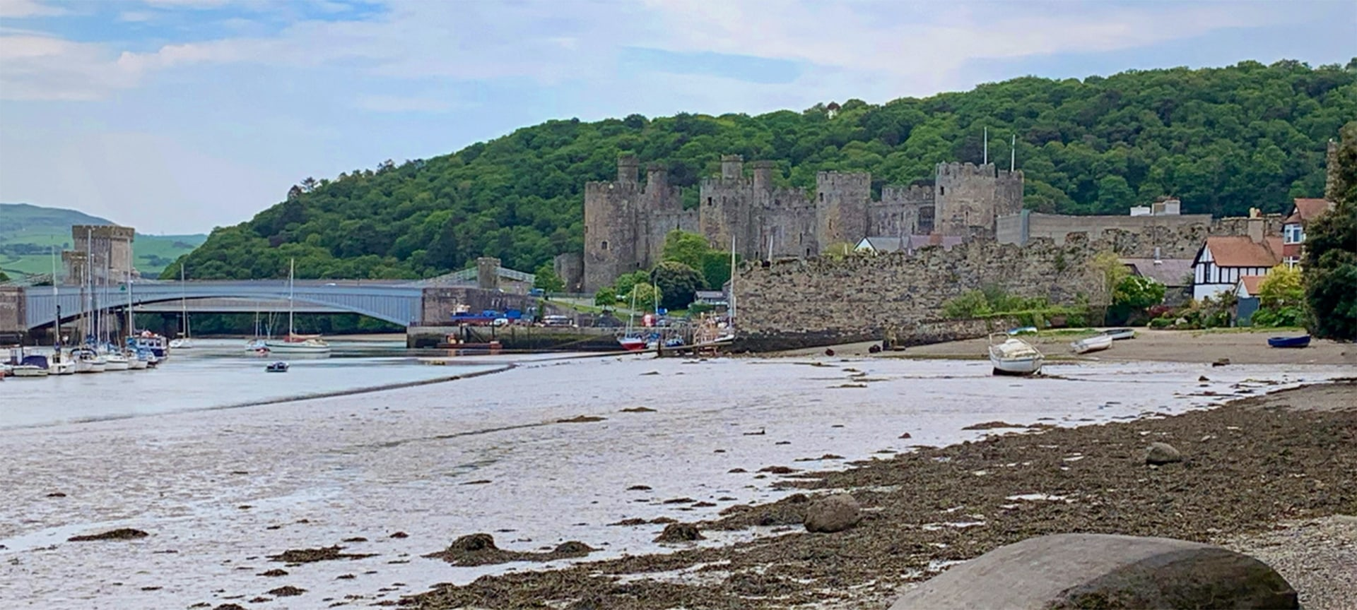 Conwy Castle's dark, brooding presence is no accident. When King Edward I built Conwy Castle in the late 13th century it was intended to dominate and intimidate – and it's still doing its job, competing with Snowdonia's rugged skyline and winning the battle for our attention. Is there another castle in Wales that evokes the atmosphere of medieval times so well? We don't think so...And we think you'll agree when you clamber up to the towers that seem to spring naturally from the dark rock on which they were built.